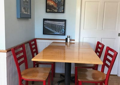 table with red chairs inside of Box Lunch restaurant